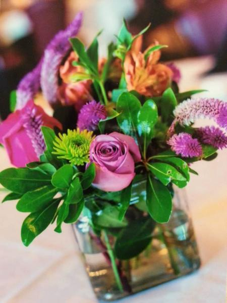 [Image: Abundant Flowers will coordinate your centerpieces to your bridal bouquet and all wedding decorations. ]